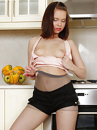 Young housewife flashing her goodies thru her stretchy hose in the kitchen pictures