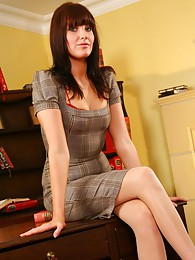 A tight dress bright red high heels and racy red lingerie make Chloe J the perfect secretary sex pictures