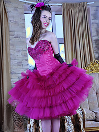 Gloved babe in a chic frilly gown with pink nylons and a matching suspender pictures