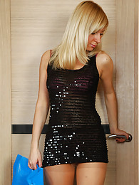 Party girl chooses a new black glittery hose to match her sequined dress pictures