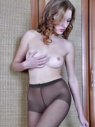 Gorgeous babe smoothens her dark control top tights and changes her dress pictures