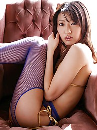 Japanese beauty is fingering her pussy through her crotchless fishnet stockings sex pictures