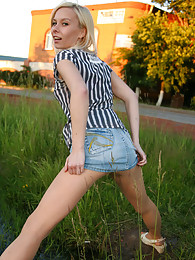 Leggy blondie flashing her pantyhose clad chow box and back parts outdoors sex pictures