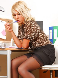 Gorgeous blonde looks sensational in her leopard print blouse black skirt and matching high heels pictures