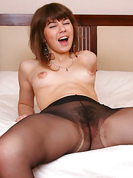 Nasty upskirt teaser flashing her bush through her barely black pantyhose sex pictures