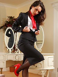 Gorgeous dark haired air hostess teases in her tight skirt suit before stripping down to her panties stockings and heels pictures