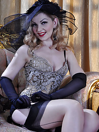 Fancily dressed lady shows off her elegant contrast top and seam stockings pictures
