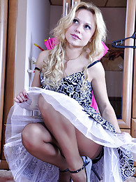 Doll-faced blonde trying on her girlie dresses with silky soft pantyhose pictures