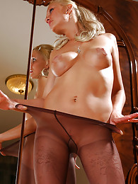 Smashing looking blonde wears just her fashion pantyhose with a sheer brief pictures