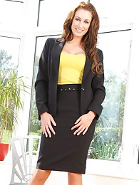 Smart secretary gets naughty and removes her black business suit pictures