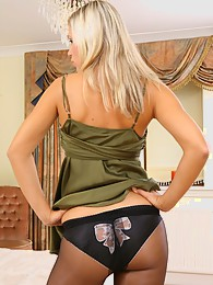Jenni P is a real stunner in her green top and black miniskirt with pantyhose sex pictures