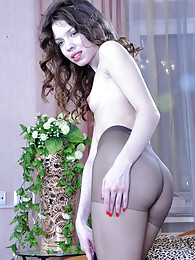 Hot seductress choosing an outfit to mach her classy control top pantyhose pictures