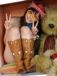 Hot Asian cowgirl  is very fuckable in her hat and boots and just waiting to go sex pictures