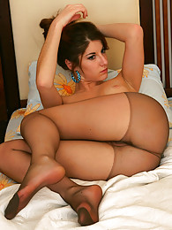 Sexy girl strips to her suntan control top pantyhose before going to bed pictures