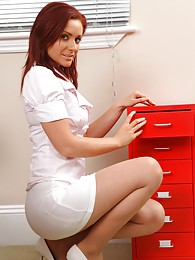 Kinky redhead teases her way out of her work clothes and poses over her desk pictures