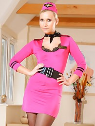 Beautiful air hostess in a tight pink minidress tights and heels pictures