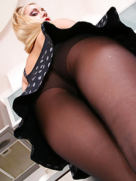 Upskirt flasher posing sexy in the kitchen in slimming control top tights pictures