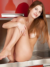 Stunning Monika Voss plays with pussy in the kitchen sex pictures