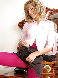 Funky office babe admires the look of her colored footless opaque tights pictures
