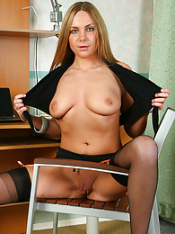 Hot office babe in a too revealing outfit with sexy black nylons and heels pictures