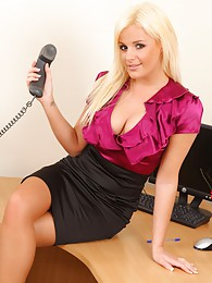 Beautiful blonde Amy Green in saucy secretary strip pictures