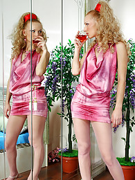 Nasty blondie slides her fav red dildo into her pink control top pantyhose sex pictures