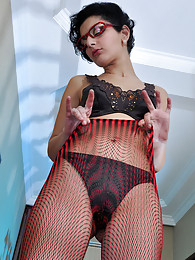 Sexy office babe pushes down her pencil skirt and gets dirty in fishnets sex pictures