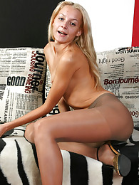 Naughty blondie lets a glimpse of her nether parts thru sheer nylon fabric sex pictures