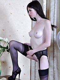 Dolled-up brunette wearing her black seamed stockings with hot stilettos sex pictures