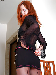 Fiery redhead in elegant black back seam tights puts on a hot strip show sex pictures