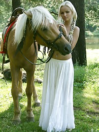 Pretty blonde riding horse naked in woods pictures